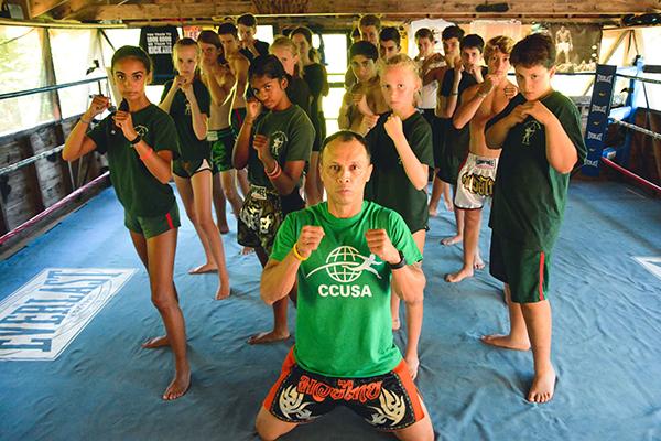 Avid Robin Hood kickboxers with Muay Thai counselor Nghia Tran